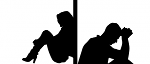 silhouette image of man and women separated by wall