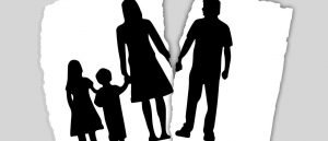 Silhouette image of family being ripped apart