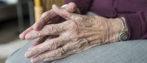 Photo of elderly person's hands together in their lap
