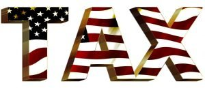 "image of the word ""tax"" decorated as the USA flag"